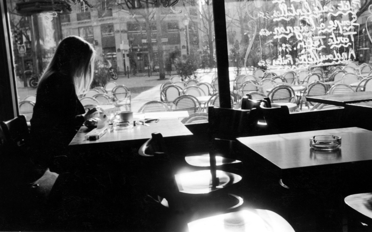 header_essay-girl-in-cafe-in-paris-120383778_master