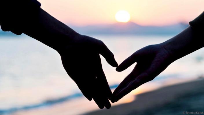 create a heart on the beach